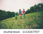 a woman with children goes...   Shutterstock . vector #1113267557