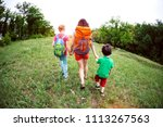 a woman with children goes...   Shutterstock . vector #1113267563