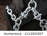 large tire with snow chains    Shutterstock . vector #1113302507