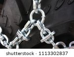 tire with snow chains    Shutterstock . vector #1113302837