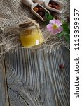 wild rose hip honey in a glass... | Shutterstock . vector #1113359357