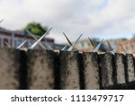 metal spikes on the top of a... | Shutterstock . vector #1113479717