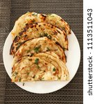 indian naan bread made with... | Shutterstock . vector #1113511043