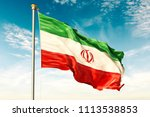 iran flag on the blue sky with... | Shutterstock . vector #1113538853