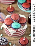 cupcakes red and blue velvet on ... | Shutterstock . vector #1113571727