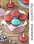cupcakes red and blue velvet on ... | Shutterstock . vector #1113571733