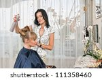 woman making a coiffure in hairdressing saloon - stock photo