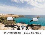 atv quad bike parked on the... | Shutterstock . vector #1113587813