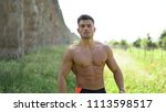 handsome man with muscular body ... | Shutterstock . vector #1113598517