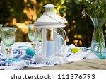 White Candle Lantern On A...