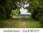 Small photo of A driveway in Gers looking beyond the gate
