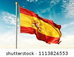 spain flag on the blue sky with ... | Shutterstock . vector #1113826553