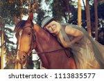 beautiful girl blond rider in... | Shutterstock . vector #1113835577