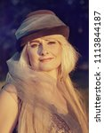 beautiful blonde woman in a... | Shutterstock . vector #1113844187