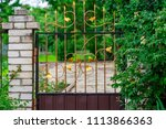 wrought iron gates  ornamental... | Shutterstock . vector #1113866363
