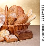 Different bread products with milk in jug on canvas - stock photo