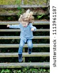 happy blond child with jeans... | Shutterstock . vector #1113961187