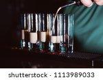 preparation of shots cocktails. ... | Shutterstock . vector #1113989033