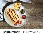 french hot dog with ketchup ... | Shutterstock . vector #1113992873
