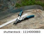 tool tinsmith. scissors on... | Shutterstock . vector #1114000883