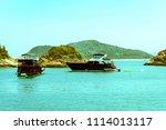 recreational boats anchoring... | Shutterstock . vector #1114013117