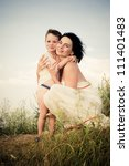 happy mother and child hugging | Shutterstock . vector #111401483