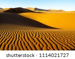Small photo of Long wind formed ripples with shadow defined edges dune dune ridges of Hidden Vlei, Sossusvlei Namibia