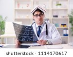 young doctor looking at x ray... | Shutterstock . vector #1114170617