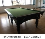 Small photo of Snooker Table, a field or place that use for playing snooker. Snooker is a sport that need to hit 9 color balls into holes in each corner of table, by hitting on white ball to attack the others.