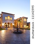 a huge new luxury home at sunset | Shutterstock . vector #11142595