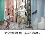 Father and son having fun outdoors in city - stock photo