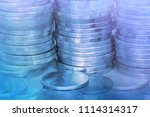 stack of coins with blue color... | Shutterstock . vector #1114314317