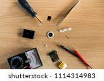 flatlay repair mp3 player on... | Shutterstock . vector #1114314983
