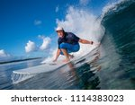 surfer riding on big waves on... | Shutterstock . vector #1114383023