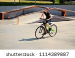 boy riding a bicycle in the... | Shutterstock . vector #1114389887