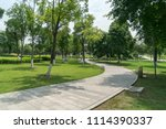 stone pathway in a lush green... | Shutterstock . vector #1114390337