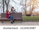 two happy cute beautiful female ... | Shutterstock . vector #1114415087