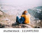 happy lesbian couple sitting on ... | Shutterstock . vector #1114491503