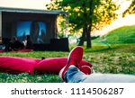 red snickers shoes on ground... | Shutterstock . vector #1114506287