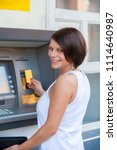 woman withdrawing money from... | Shutterstock . vector #1114640987