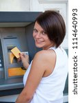 woman withdrawing money from... | Shutterstock . vector #1114640993