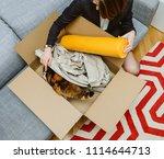 business woman unpacking... | Shutterstock . vector #1114644713