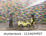 happy child washes yellow toy... | Shutterstock . vector #1114654907