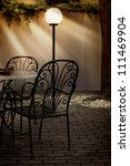 Dining table and chairs and the lamp in a restaurant - stock photo