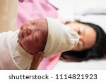 mother giving birth to a baby.... | Shutterstock . vector #1114821923