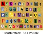 Colorful Alphabet Letters over cork background - stock photo