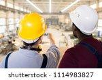 rear view of multiethnic... | Shutterstock . vector #1114983827