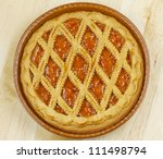 A crostata cake, over a wooden background - stock photo