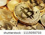 heap of golden bitcoin closeup | Shutterstock . vector #1115050733
