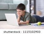 cute little boy using laptop...   Shutterstock . vector #1115102903